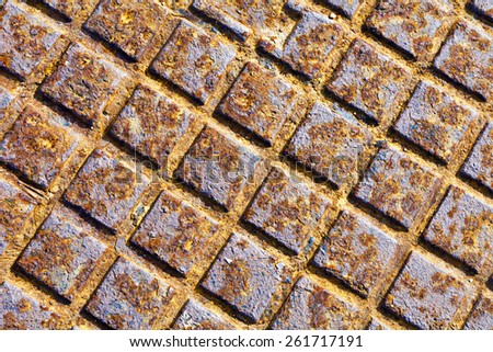 Texture of an old and rusty manhole cover - stock photo