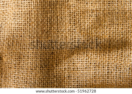Texture of an old, dirty potatoes sack. - stock photo