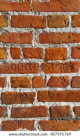 Texture of ancient red brick wall closeup - stock photo