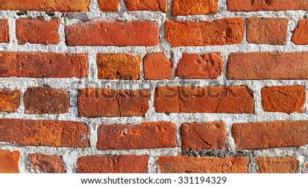 Texture of ancient red brick wall closeup - stock photo