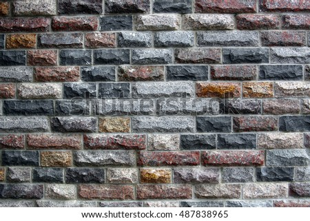 Texture of ancient wall of colored bricks