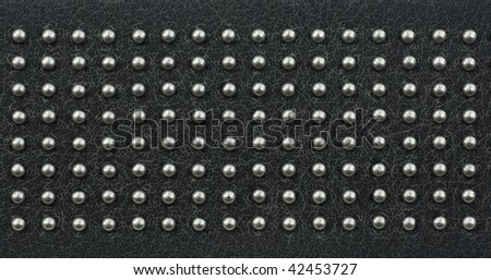 texture of artificial grey leather band with regularly placed metal dot - stock photo