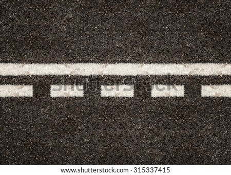 Texture of asphalt road with white line