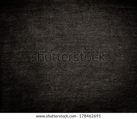 Texture of black jeans textile close up - stock photo