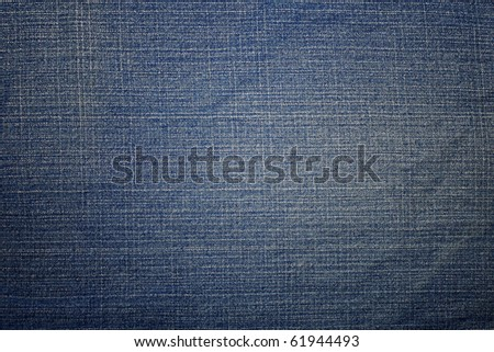 Texture of blue jeans as a background. - stock photo