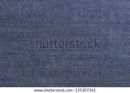 Texture of blue jeans textile macro - stock photo