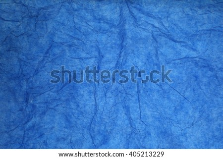 Texture of blue striped crumpled paper for pattern background
