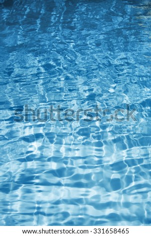 Texture of blue water. Vertical photo - stock photo