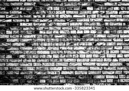 Texture of brick wall black and white high contrasted with vignetting effect - stock photo