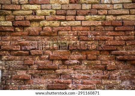 Texture of brick wall. Old, aged, weathered wall.