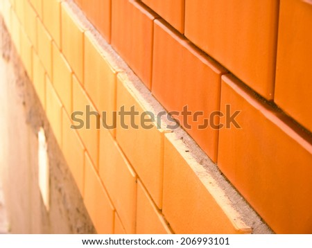 Texture of brick wall with two different colors of bricks.