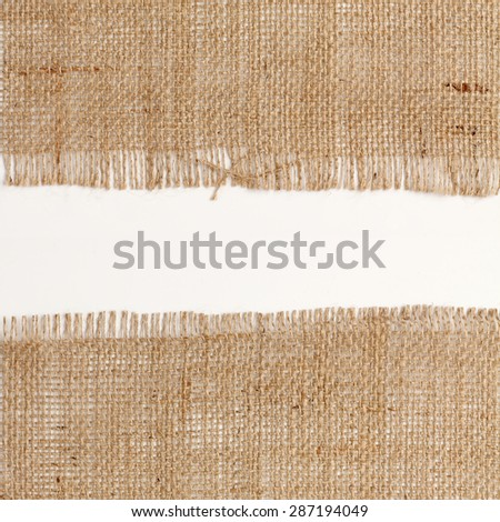 texture of Burlap hessian square with frayed edges on white background white space - stock photo