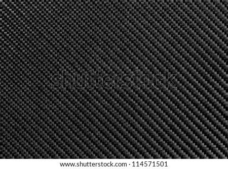Texture of Carbon Kevlar Fiber material. Dark background. Hi Detailed Photo. - stock photo