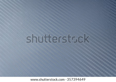 Texture of carbon kevlar fiber material for background. - stock photo
