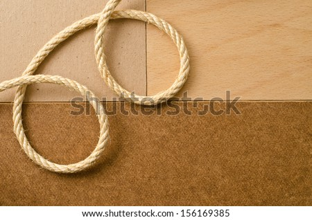 Texture of cardboard, wood, pressed cardboard and  rope  - stock photo
