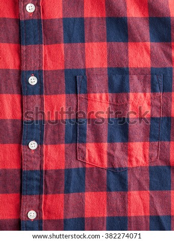Texture of checkered flannel shirt with buttons and pocket - stock photo
