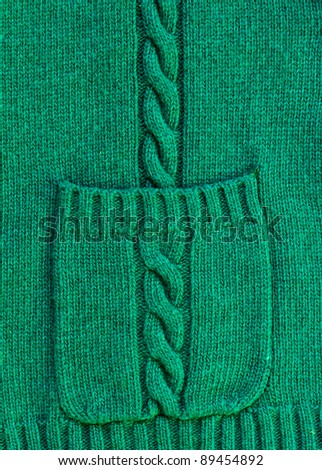 texture of christmas green knitted wool sweater background with pocket - stock photo