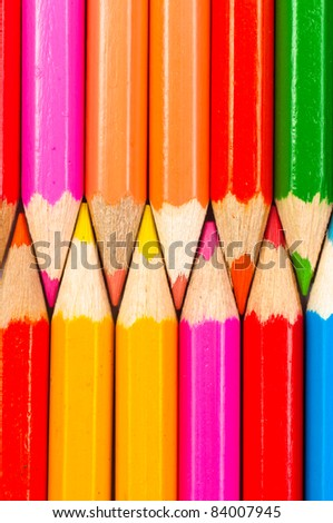 Texture of colorful pencils lined up in a row - stock photo