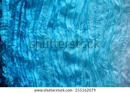 Texture of crumpled fabric in blue color. Shallow depth of field - stock photo