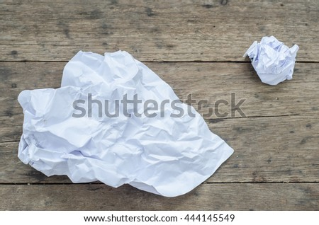 Texture of crumpled paper on wood board background