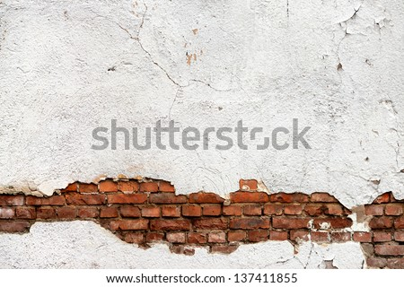 Texture of damaged brick wall - stock photo