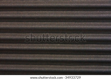 texture of dark-faced corrugated cardboard close up