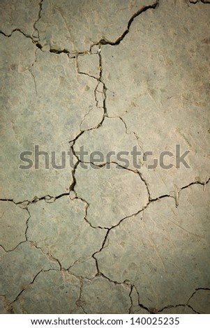 texture of dry soil with cracks - stock photo