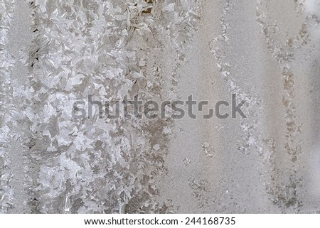 texture of frosty glass with an abstract pattern from hoarfrost - stock photo
