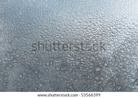 texture of frozen water drops on glass - stock photo
