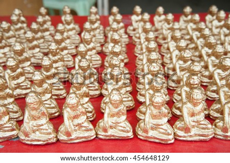 Texture of golden little buddha statue in Myanmar - stock photo