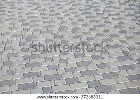 texture of grey cobblestone road - stock photo