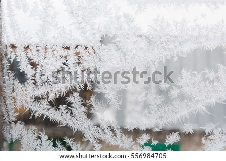 Texture of ice at a window. A frost at a window. Background ice
