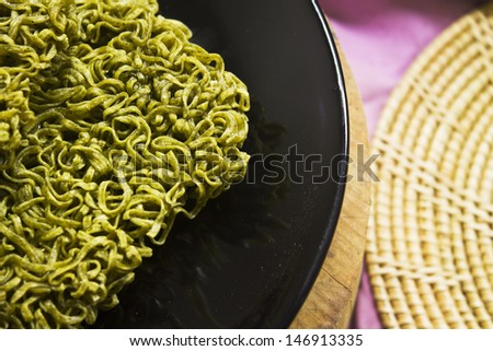Texture of instant noodle on black plate - stock photo
