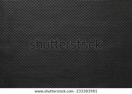 texture of leather fabric with outer side for pure backgrounds of black color with the punched openings