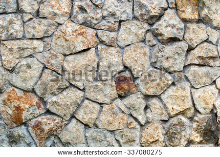 Texture of Masonry Wall of colors stones with irregular pattern. Background  - stock photo