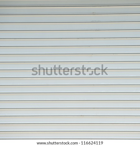 Texture of metal door surface. - stock photo