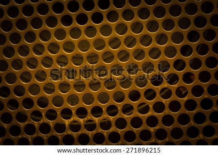 Texture of metal with holes - speaker front side. Texture useful as background - stock photo