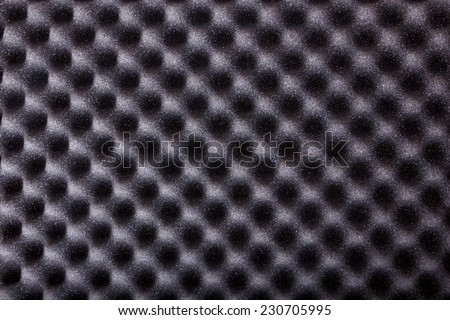 texture of microfiber insulation for noise in music studio or acoustic halls or houses , professional studio insulation material , noise isolation , noise isolating protective absorber wall - stock photo