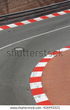 Texture of Motor Race Asphalt and Curb on Monaco Montecarlo Grand Prix Street - stock photo