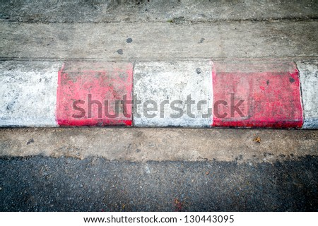 Texture of motor race asphalt and red white curb - stock photo