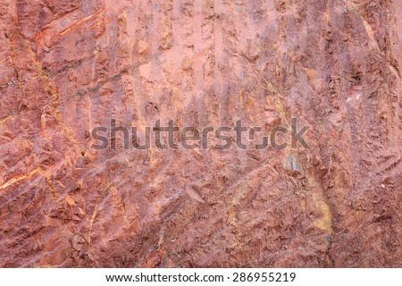 Texture of mountain showing red soil and rock after excavated - stock photo