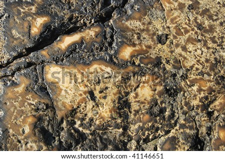 Texture of natural stone colored yellow and black