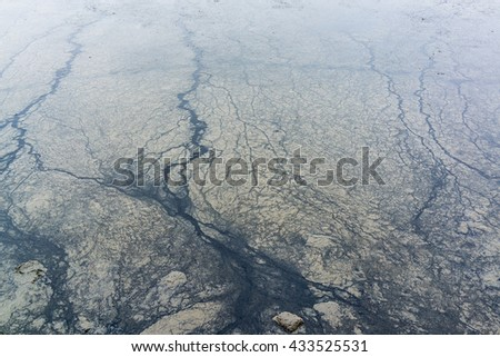 Texture of oil and mud on polluted beach. - stock photo