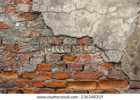 Texture of old brick wall with chipped plaster - stock photo