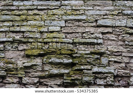 Texture of old destroyed gray stone wall