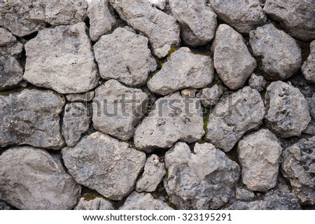 Texture of old rock wall for background - stock photo