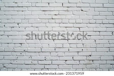 Texture of old rustic brick wall painted with white paint - stock photo