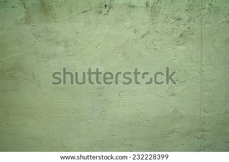 Texture of old rustic wall covered with green stucco