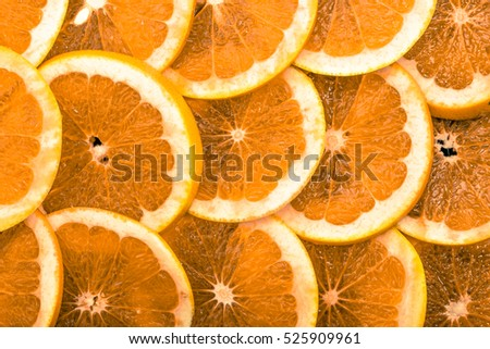 Texture of orange slices, closeup, overhead, citrus background