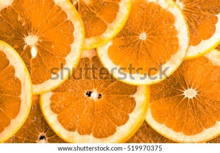 Texture of orange slices, top view, closeup, citrus background